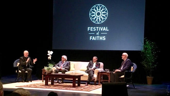 Arun Gandhi (seated on the left) joined Archbishop Joseph Kurtz and the Rev. Allen Boesak in a panel discussion of faith during the Festival of Faiths.