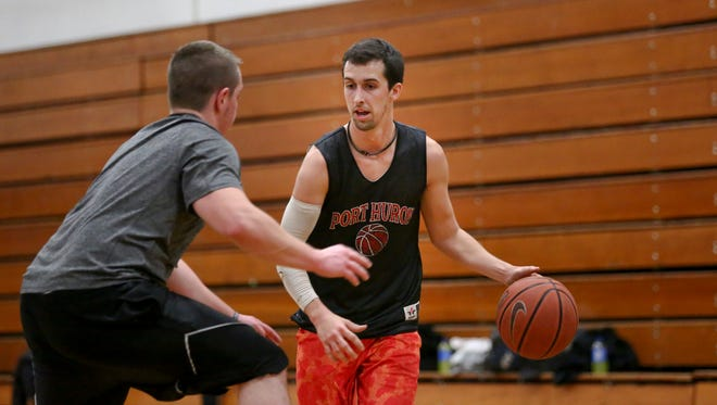 Billy Lemon, of Port Huron, works the ball down court during a drop-in basketball game through the recreation department Wednesday, Dec. 16, 2015 at Marysville Middle School.