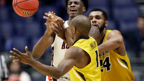 Auburn forward Danjel Purifoy, left, loses the ball