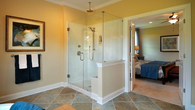 Many newer homes, like this one from The Jones Co., skip the traditional tub and shower combo in favor of a luxury shower.