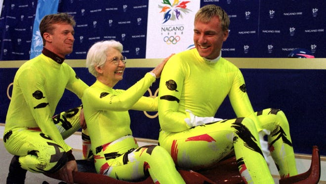 Dorothy Mengering meets the U.S. luge crew at the 1998 Winter Olympics in Nagano, Japan.