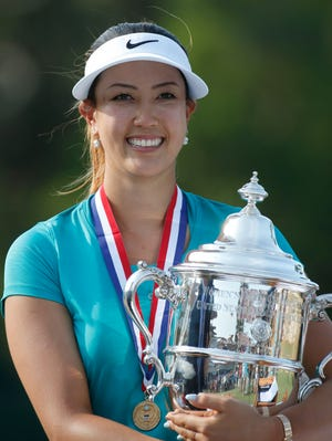 Michelle Wie holds the trophy after winning the U.S. Women's Open golf tournament in Pinehurst, N.C., Sunday, June 22, 2014.