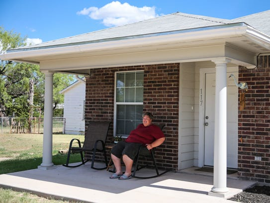 Tara Davis sits outside her home July 20 in San Angelo.
