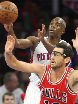 Detroit Pistons guard Jodie Meeks rebounds against the Chicago Bulls' Kirk Hinrich on Oct. 7, 2014, at the Palace of Auburn Hills.