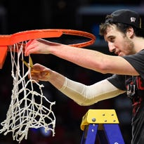 Wisconsin Badgers forward Frank Kaminsky (44) cuts a piece of the net after the 85-78 victory against Arizona Wildcats following the finals of the west regional of the 2015 NCAA Tournament at Staples Center.