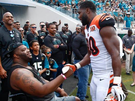 Cincinnati Bengals defensive end Michael Johnson visits