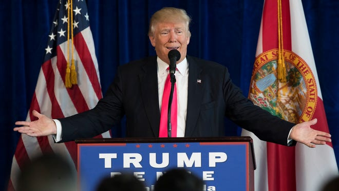 President-elect Donald Trump speaks during a news conference at Trump National Doral, Wednesday, July 27, 2016, in Tampa, Fla.