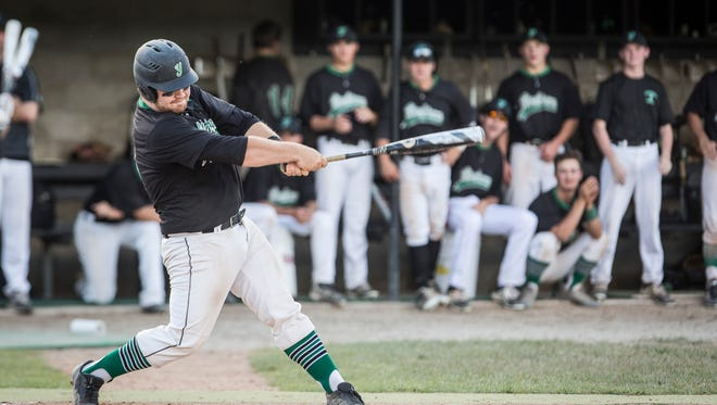 Yorktown's Matt Phillips, catcher, takes a swing at the pitch from Delta during the Yorktown Sectional on May 29 at Yorktown High School. Yorktown won 12-8.