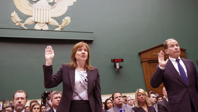 General Motors CEO Mary Barra, CEO, left, and former US Attorney Anton Valukas, investigator, Jenner & Block, are sworn-in on Capitol Hill in Washington, Wednesday, June 18, 2014, prior to testifying before the House Energy and Commerce Committee's Oversight and Investigations subcommittee hearing on examining the facts and circumstances that contributed to General Motors' failure to identify a safety defect in certain ignition switches and initiate a recall in a timely manner. (AP Photo/Cliff Owen)