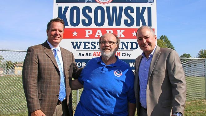 At the dedication of a field named in his honor, State Rep. Robert Kosowski, D-Westland, (left), with Henry Johnson and Westland Mayor William Wild.
