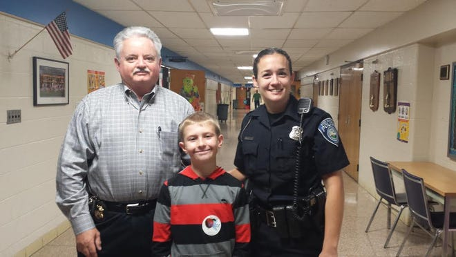 Nolan Michaluk, a sixth grader at Holland Woods Middle School, won the 2013-2014 D.A.R.E. essay contest. Officer Adrianne Mynsberge, a D.A.R.E. liaison, and Port Huron Public Safety Director Michael Reaves, presented Nolan with a check for $100, which Nolan said will go into his college account.