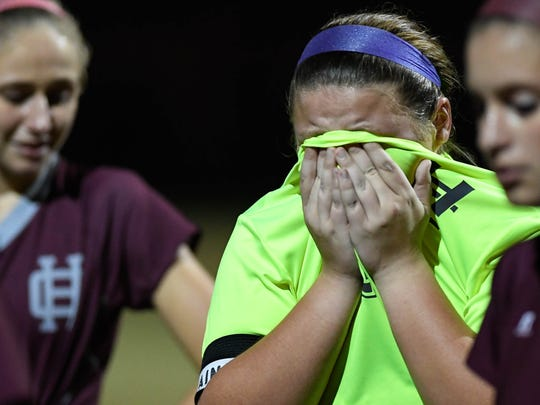 Henderson goalie Ashlee Wilson reacts after the Colonels lose to Owensboro Catholic as the No. 11 Lady Colonels play No. 5 Owensboro Catholic in the semistate in Owensboro Monday, October 24, 2016.