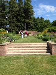 Visitors stop in July 2014 to smell the flowers in