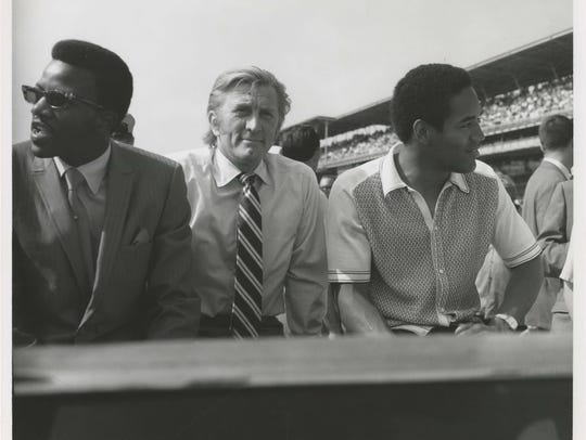 Actor Kirk Douglas and foootbal star O.J. Simpson at