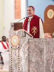 In this Nov. 30 file photo, Coadjutor Archbishop Michael