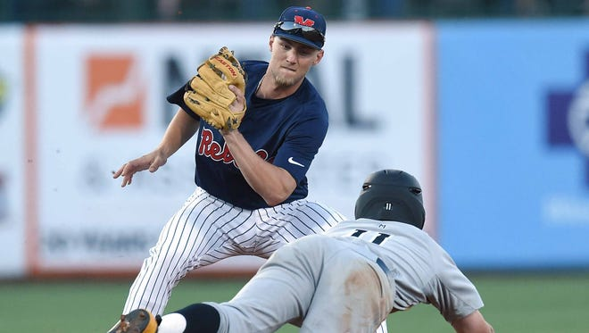 Ole Miss shortstop Grae Kessinger takes the throw before tagging out Southern Miss base runner Mason Irby at seconed on Tuesday at Trustmark Park in Pearl, Miss.