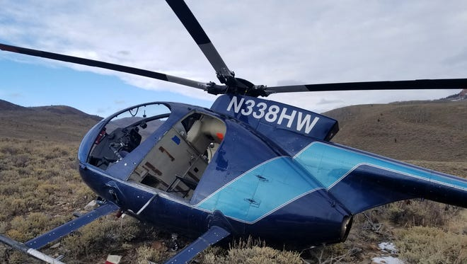 In this photo taken Monday, Feb. 12, 2018, and provided by the Wasatch County Sheriff's Office is a research helicopter that was brought down by a leaping elk in the mountains of eastern Utah.