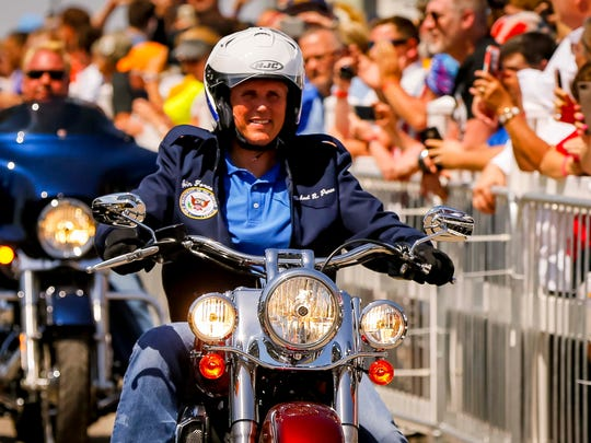 Vice President Mike Pence rides a motorcycle in with
