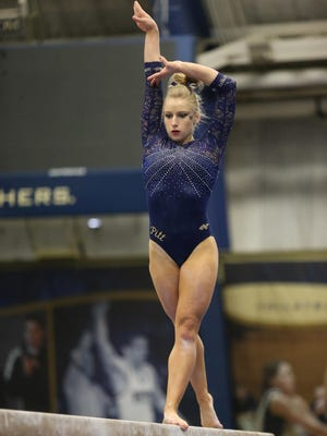 The University of Pittsburgh's Lindsay Offutt competes on the balance beam in a dual meet March 13 against West Virginia at Fitzgerald Field House.