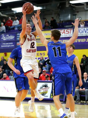 Pacelli player Andrew Blanker, defended by Amherst player Marcus Glodowski, attempts to make a basket during the Sentry Classic basketball tournament at the University of Wisconsin-Stevens Point in Stevens Point, Wis., December 30, 2017.