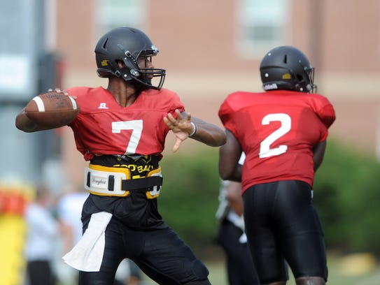 Southern Miss quarterbacks Kwadra Griggs,left, and