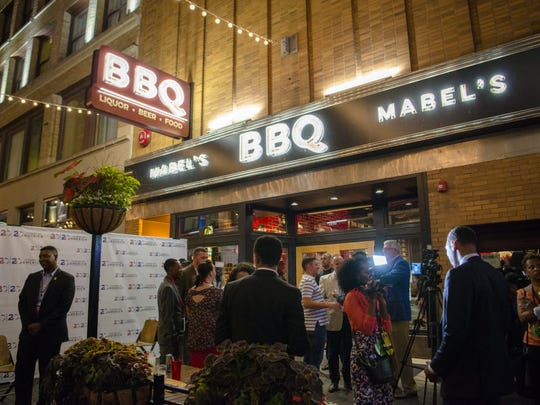 Members of various delegations to the 2016 Republican National Convention gather to promote diversity at Mabel's BBQ in Cleveland on July 19, 2016, during the 20/20 Leaders of America (Code) RED party after the end of the convention's second day.