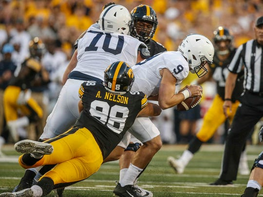 Iowa sophomore defensive end Anthony Nelson sacks Penn State quarterback Trace McSorley on Saturday, Sept. 23, 2017, at Kinnick Stadium in Iowa City.
