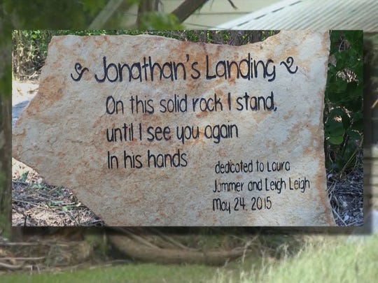 A stone marker placed at the spot where Jonathan McComb made it to safety is dedicated to his family that did not make it.