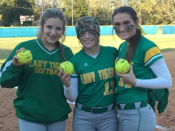 Castor's Zoey Cheatwood, Kelsey Giddens and Faith Nailes display their homerun balls.