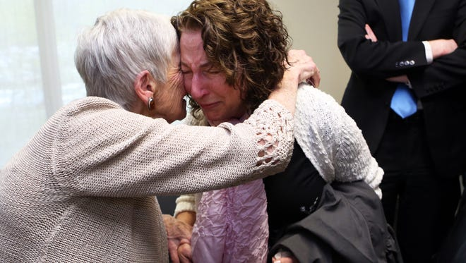 Enid Weishaus of Upper Nyack, who lost her mother's side of the family in the Holocaust, is emotional after introducing herself to survivor activist Trudy Album of Suffern, who spoke at the Holocaust Remembrance Day ceremony at the Rockland County Courthouse April 24, 2017 in New City.