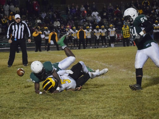 Peabody's Jordan Gaston (29, far left) forces a fumble from St. James quarterback DeMarcus Williams (5, center) which was recovered by David Overstreet (54, right) in the first round of the LHSAA Class 3A playoffs held Friday, Nov. 11, 2016.