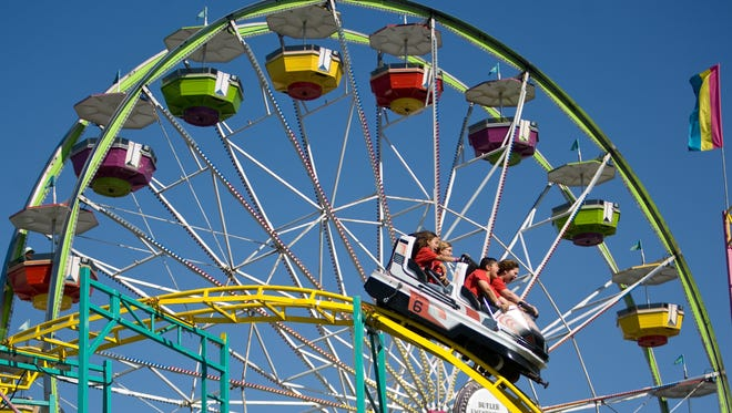 A Ferris wheel and a roller coaster are among the carnival rides that make the Maricopa County Fair a blast.