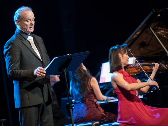 Comedy great Bill Murray sang songs and offered literary readings at the Riverside Theater Tuesday night, at a concert joined by cellist Jan Vogler, violinist Mira Wang and pianist Vanessa Perez.