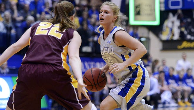 South Dakota State's Chloe Cornemann dribbles past Minnesota's Joanna Hedstrom in Thursday's 3rd round WNIT basketball game at Frost Arena in Brookings, S.D. March 27, 2014. SDSU beat Minnesota 70-62.   (Elisha Page / Argus Leader)