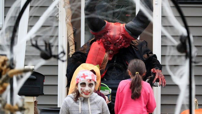 Trick-or-treaters go in search of candy on Halloween in 2017 in Green Bay.
