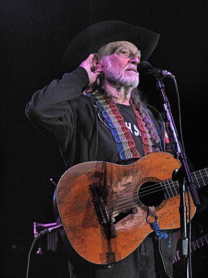 Willie Nelson listens to fans singing with him during his performance at the Woods Amphitheater at Fontanel on May 16, 2014.