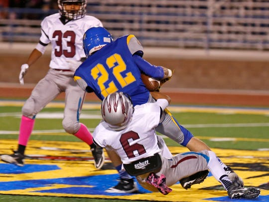 Shiprock's Quaid Shorty takes down Bloomfield runner
