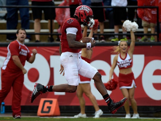 UL Ragin' Cajuns wide receiver Jamal Robinson (4) leaps into the end zone for a touchdown during the first half of an NCAA football game against the Southern University Jaguars at Cajun Field in Lafayette, La., Saturday, Aug. 30, 2014.  Paul Kieu, The Advertiser