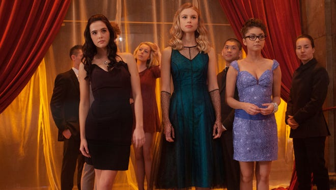 Zoey Deutch, left, Lucy Fry and Sarah Hyland, attend 'Vampire Academy,' a highly unusual high school.