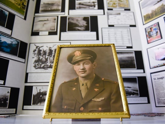 A photo of Don Fish and a display created by his family