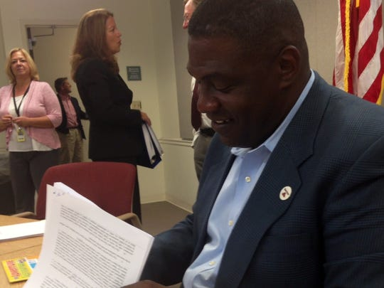 Brevard County Commission Chairman Robin Fisher signs the agreement with the Washington Nationals and The Viera Co. related to the facilities surrounding Space Coast Stadium after Thursday's Brevard County Commission vote.