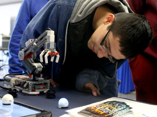 Christopher Moreno views a robot that the Nueces County Library Systems during the Discover Your Direction Conference on Thursday, Feb. 9, 2017, at the Education Service Center Region 2 in Corpus Christi.