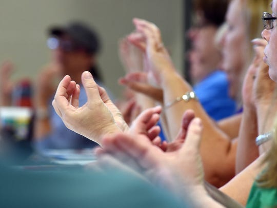 Attendees sign a word at a sign language class at Starlight