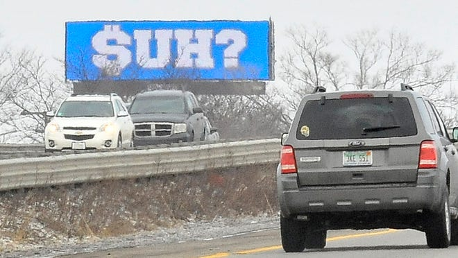 """First spotted Wednesday morning, multiple electronic billboards around the metro area now have one slide that simply reads, """"$UH?"""" One billboard is along southbound I-75 in Madison Heights."""