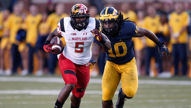 Maryland's Wes Brown tries to outrun Michigan's Devin Bush after a catch Nov. 5 at Michigan Stadium.