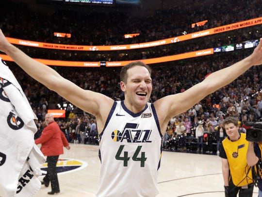 Utah Jazz forward Bojan Bogdanovic (44) celebrates after scoring the winning shot in the team's NBA basketball game against the Milwaukee Bucks on Friday, Nov. 8, 2019, in Salt Lake City. (AP Photo/Rick Bowmer)