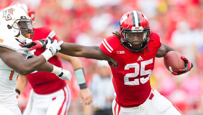Wisconsin running back Melvin Gordon rushes past a Bowling Green defender.
