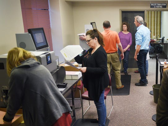 Voting ballots are dropped off at the County Admin