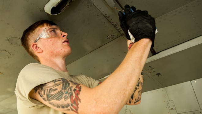 Airman 1st Class Logan Jackson, an aircraft structural maintenance technician with the 49th Maintenance Squadron, touches up the bottom of an F-16 Fighting Falcon with paint at Holloman Air Force Base on Nov. 10, to prevent deterioration. Technicians like Jackson are responsible for the upkeep of aircraft when it comes to preventing corrosion.