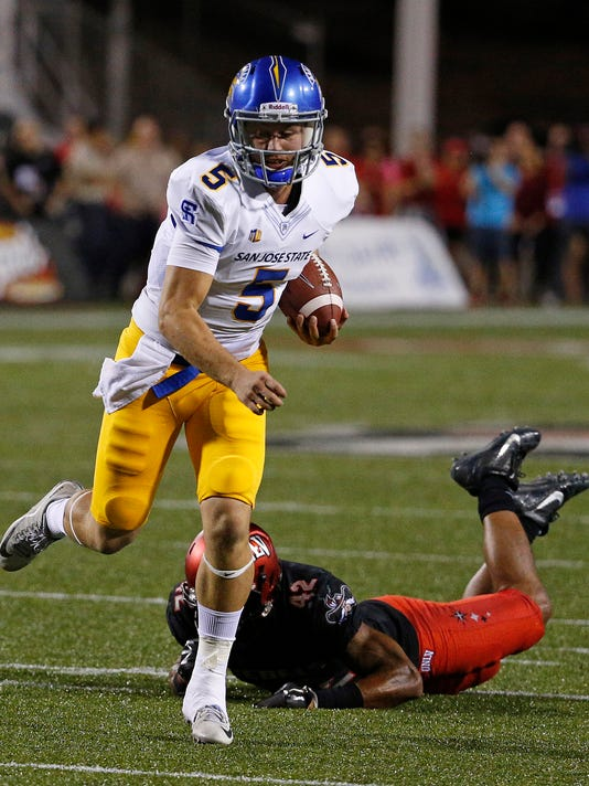 San Jose State quarterback Kenny Potter breaks a tackle attempt by UNLV defensive back Peni Vea during the first half of an NCAA college football game Saturday, Oct. 10, 2015, in Las Vegas. Potter scored a touchdown on the play. (AP Photo/John Locher)